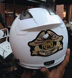 One of the bikers shows off his official gear