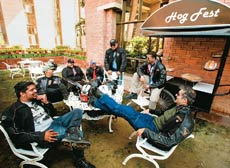 Members of the Delhi HOG unwind outside the All-American Diner on a Sunday morning