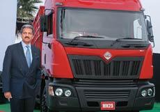 Anand Mahindra with a Mahindra Navistar truck
