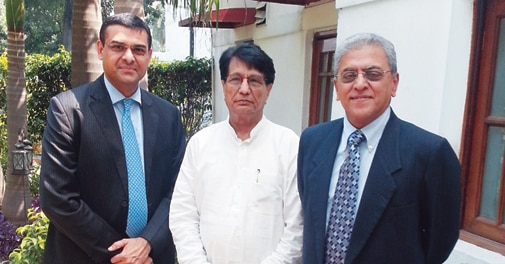 Prasad Menon (right), Chairmannominee of the proposed board of the new airline and Mukund Rajan, one of the directors, with Civil Aviation Minister Ajit Singh (centre)