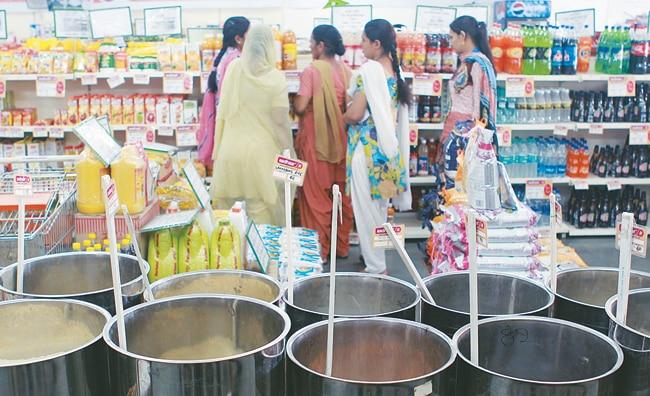 Villagers shop at an Aadhaar store in Punjab