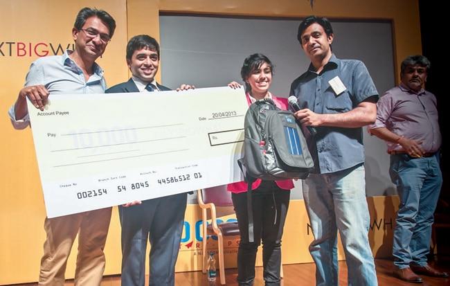 Google India MD Rajan Anandan (left) gives a Rs 25 lakh cheque to solar backpack makers Gandharv Bakshi and Lavina Mahbubani
