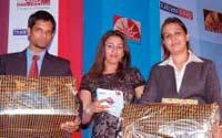 Debate winners: Apurva Harsh and Cheishta Katyal of IIFT Kolkata with compere Puja Yadav (centre)