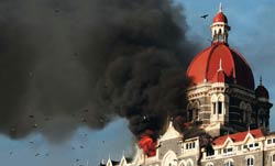 Smoke billows out of the Taj Hotel after the attack