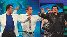 From left to right: Host Salman Khan with Bollywood stars Akshaye Khanna and Anil Kapoor inside the live studio of Bigg Boss 4