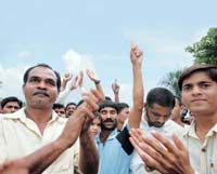 Villagers are unlikely to let go of their land: Protesting villagers shouting slogans against land acquisition and SEZ