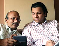 Ramnik Chauhan (left) with son Chintan
