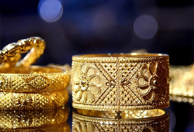 Gold price trades flat for second day; silver rates at Rs 61,500