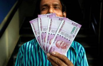 Rupee settles 8 paise higher at 68.42 vs USD on Budget day