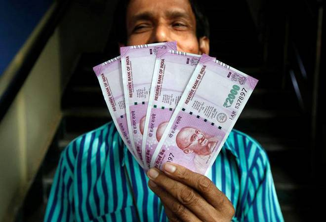 Rupee gains 16 paise to 70.09 vs USD in early trade