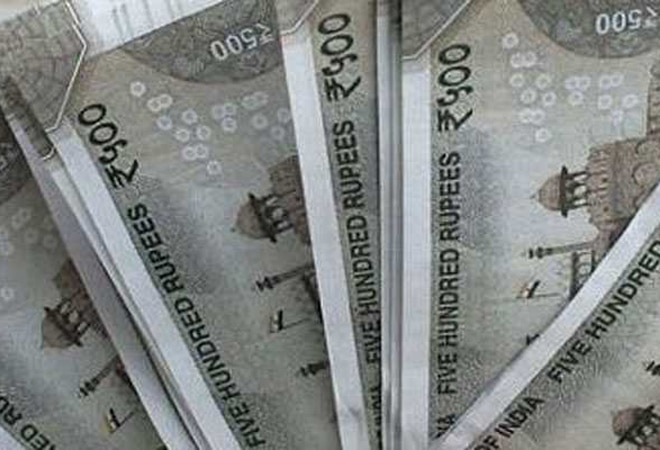 Rupee edges 4 paise lower to 73.03 per dollar amid weak equities