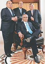 The Hinduja brothers: Srichand (seated); Gopichand(Left), Prakash(Right) & Ashok