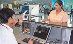 Everything under control: Staff carry out a mock check-in to test the systems