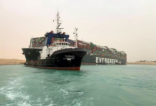 Rock under vessel's bow complicates efforts to dislodge ship blocking Suez Canal