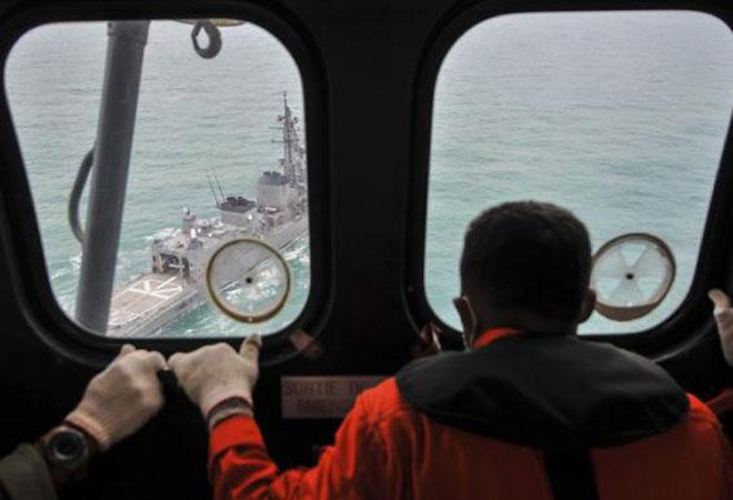 AirAsia jet tail found underwater, black box may be close