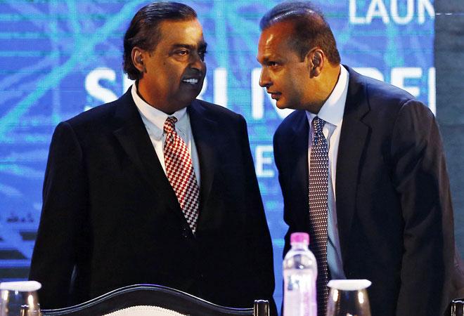 Reliance Industries Chairman Mukesh Ambani (L) with Reliance Group Chairman Anil Ambani