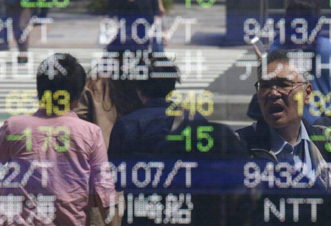 Asia stocks hit three and a half month high on Dow's surge, dollar slips