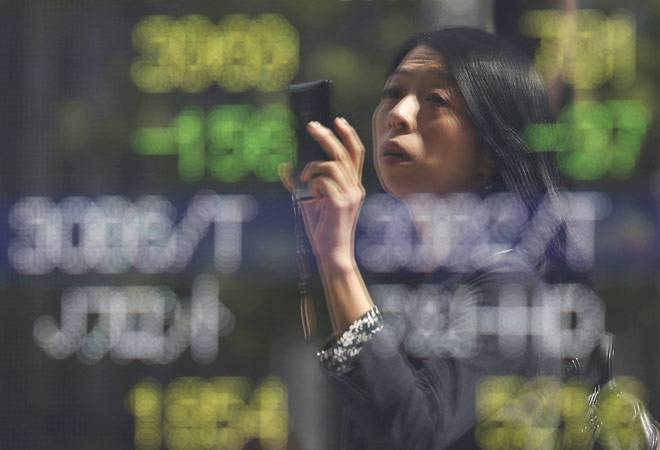 Asian shares slip from two-month high, oil regroups after slide