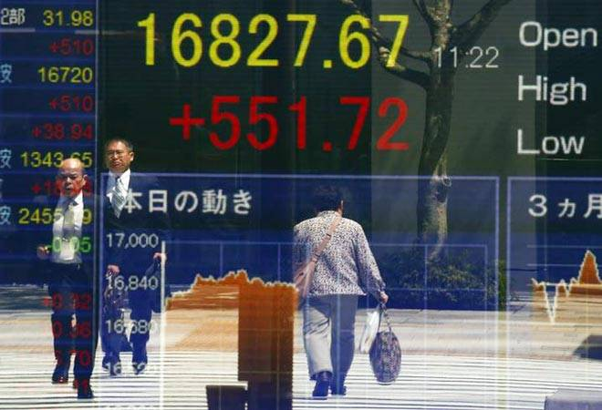Asian shares wobble, knocked by Wall Street losses