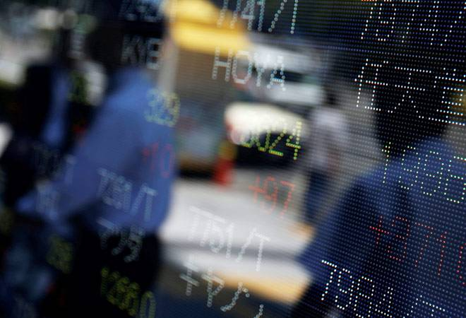 Asian markets slip as focus shifts to US presidential debate