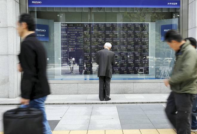 Asian stocks track Wall Street's rally despite global worries