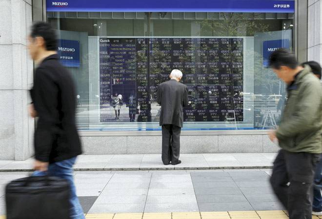 Asia shares hit 2008 highs, dollar in decline on Fed inflation view