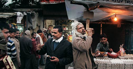 People queue up outside a liquor shop Bihar