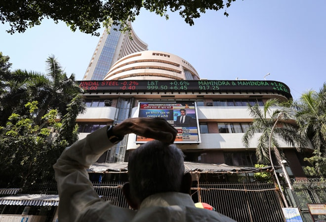 Sensex slides another 259 points on muted earnings