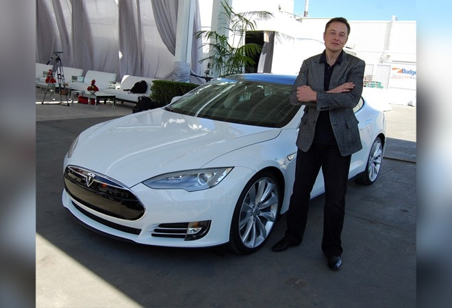 Elon Musk defies skeptics, meets Tesla delivery goal; shares hit record high