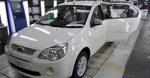 Slowdown dents auto sector profits in 2013 as sales drop