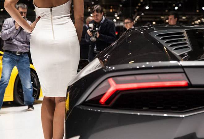 Why every big car launch has a woman next to the vehicle