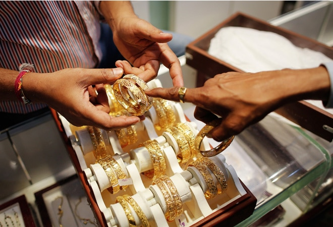 Gold demand slows as China eyes equities; lack of weddings in India weighs