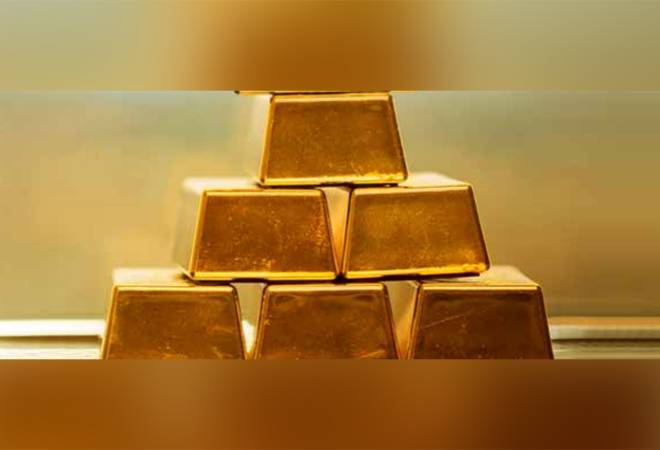 Gold price trades near record high; silver eases on profit-booking