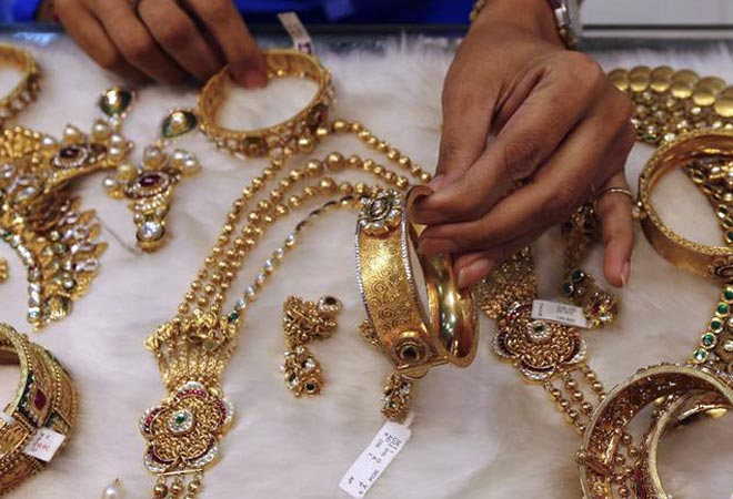 Gold prices end steady, silver firms up on industrial offtake