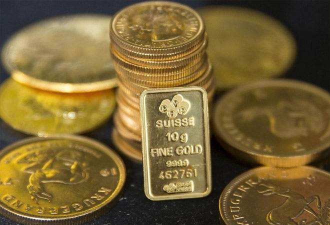 Gold prices fall over stronger dollar, hopes for swift global economic recovery