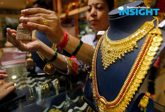 BT Insight: Gold prices at record high of Rs 48,980; should you buy, hold or exit?