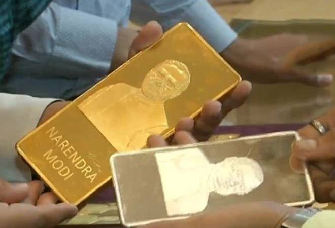 Jewellery Shop In Surat Sells Gold Bars With Pm Modis Image