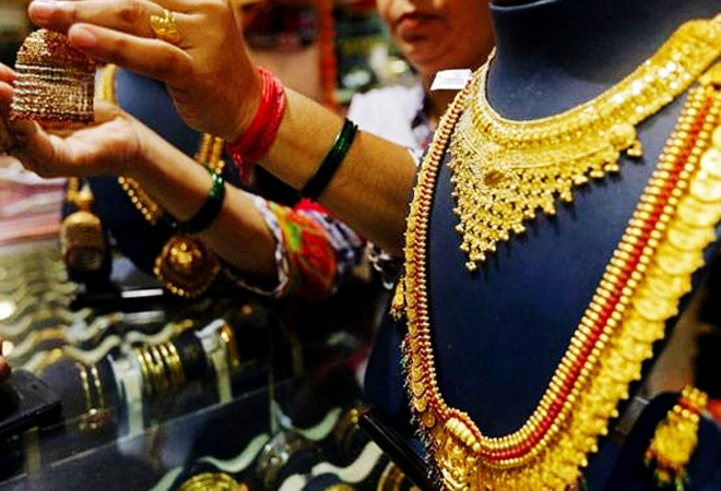 Gold may become cheaper, slumps over Rs 4,000 per 10 gram from this month's high