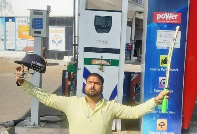 Man poses with cricket bat, helmet as premium petrol price hits a century in Bhopal