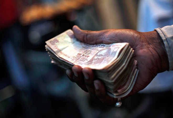 Rupee recovers on dollar selling, equity mkts