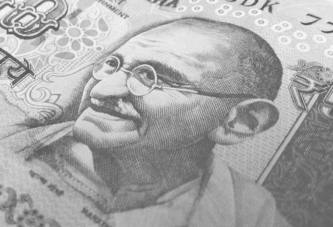 Rupee vs Dollar: Rupee rises 12 paise to 70.82 per dollar amid positive global cues