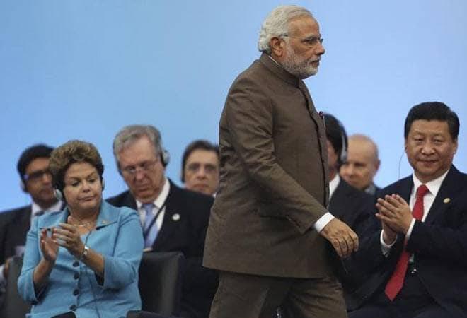 India's economy seen limping behind China amid Narendra Modi's return