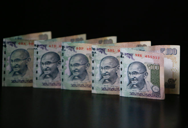 Rupee ends higher 4 paise against dollar