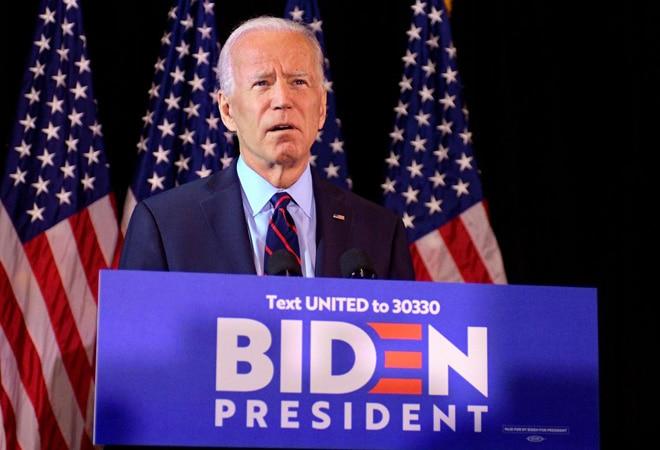 Joe Biden twists foot while playing with dog Major