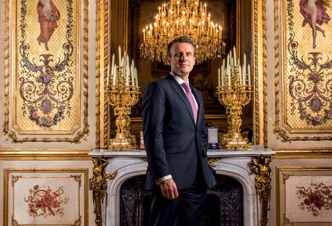 Macron foresees summer tourists in Paris on COVID-19 negative test report, vaccination