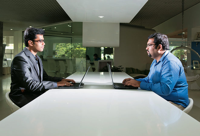 Ali Akbar, armed with an MBA (left), and non-MBA Raghuraman S. at the Godrej office