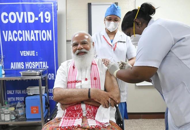 Remove PM Modi's picture from vaccine certificates, follow poll code: EC to centre