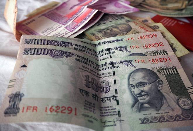 Rupee slips 13 paise to 74.32 against US dollar in early trade