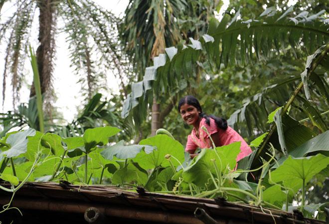 Monika Barman, a teenager from Cooch Behar, tends to her 'terrace garden'