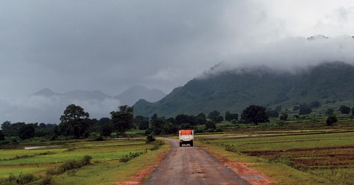 The road towards Khambesi village, in Rayagada district, with Niyamgiri hills as the backdrop